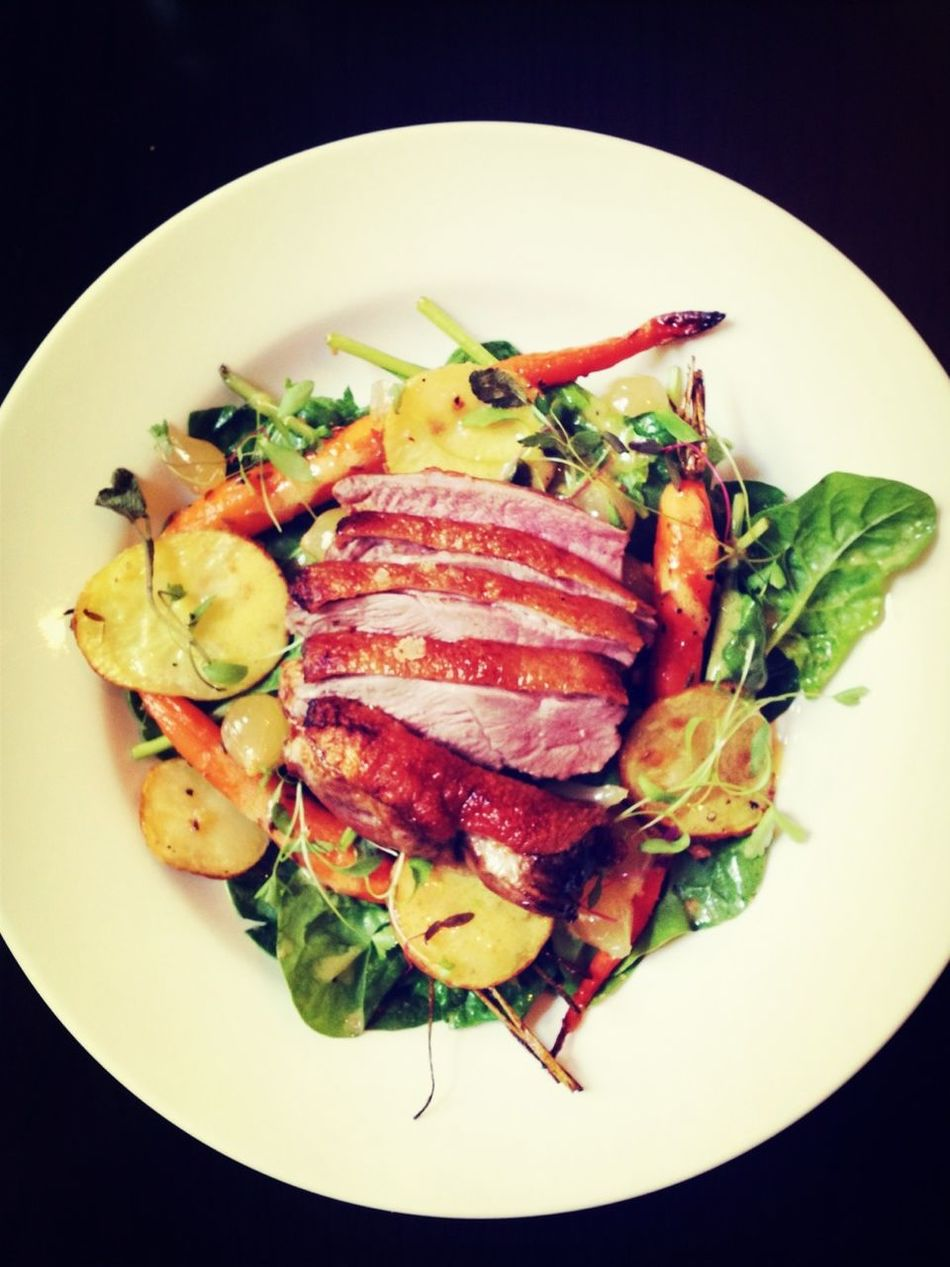 "Nhill's own ""Luv-a-Duck"" Duck breast (tender juicy duck breast pan seared and finished in the oven, served with Spinach, Potatoes, Bacon, Pear Onions and Baby Carrots)"