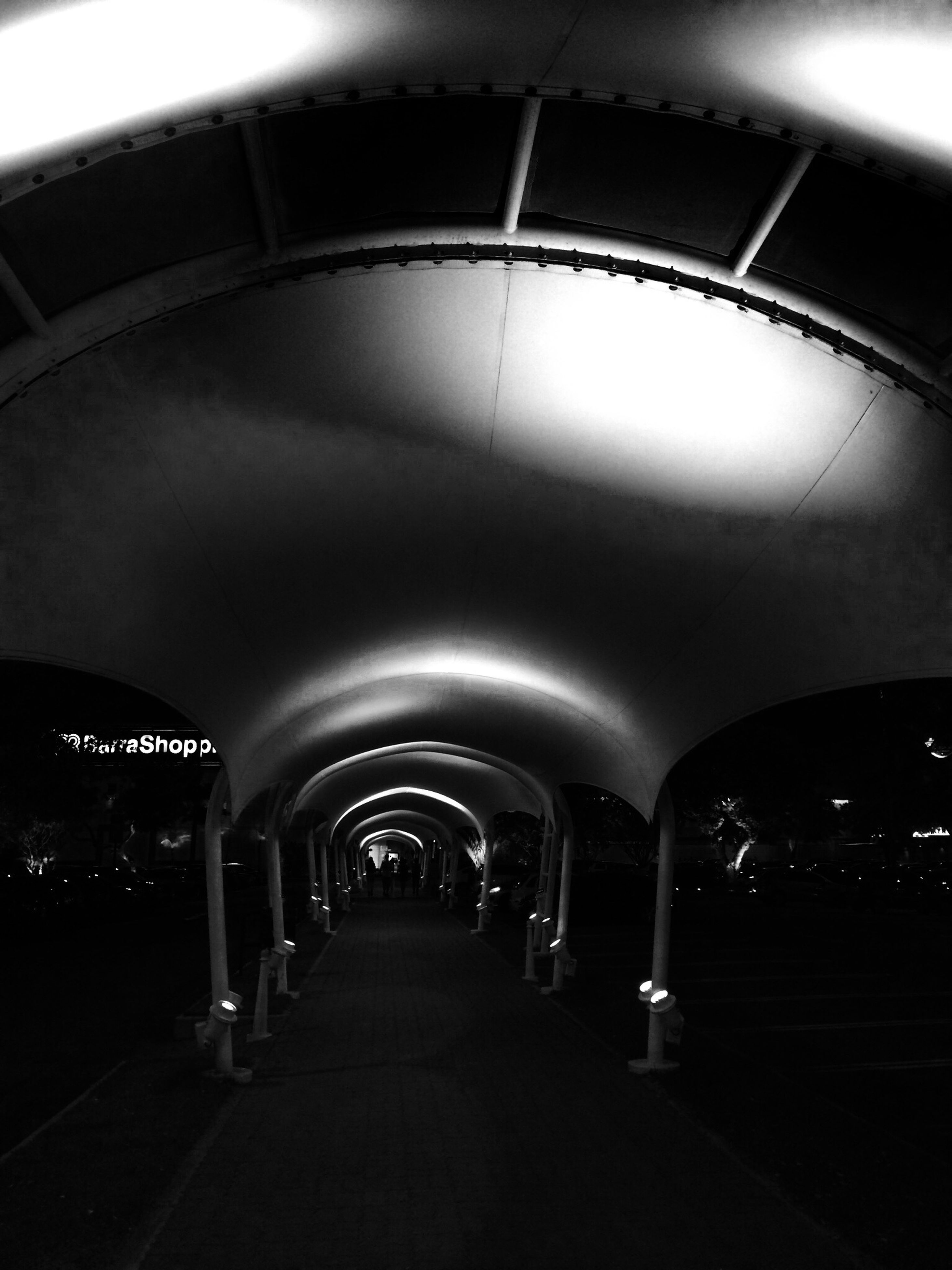 indoors, illuminated, arch, ceiling, the way forward, tunnel, lighting equipment, diminishing perspective, transportation, built structure, architecture, empty, vanishing point, in a row, subway, interior, absence, underground, corridor, no people