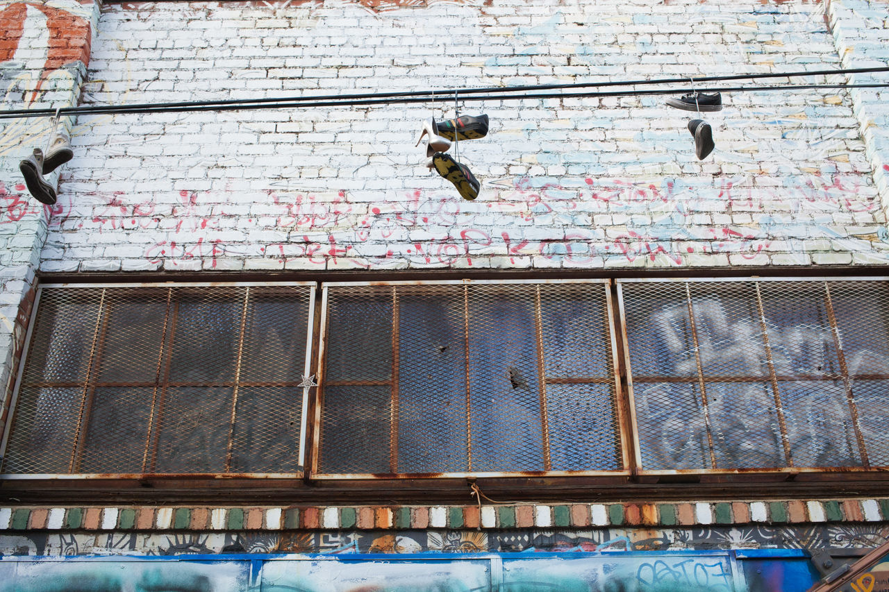 Alleys Alleyways Built Structure City Decay Hanging Shoes Outdoors Rustic Shoes Street Art Street Photography Urban Geometry Urban Scene