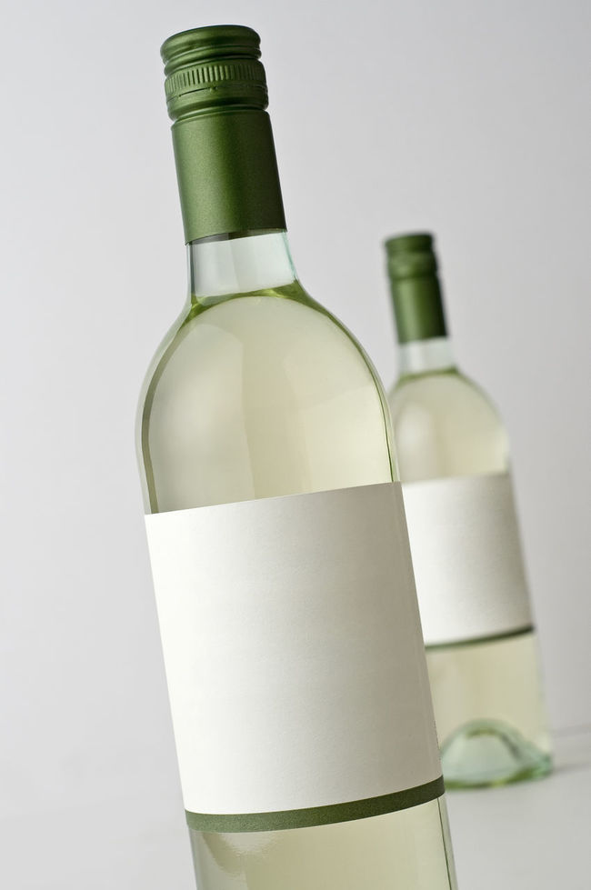 Wine bottles, blank labels Alcohol Bottles Blank Label Close-up Focus On Foreground No Vintage Product Photography Sauvignon Blanc Selective Focus Still Life Studio Shot Two Objects Vertical Composition White Wine Wine Bottles