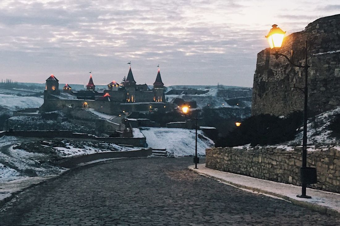 Kamianets-Podilskyi KamyanetsPodilsky Ukraine Eastern Europe Europe Ussr Architecture Built Structure Sunset Building Exterior History Travel Destinations Sea Sky Outdoors Illuminated Nature No People Water Winter Cold Temperature Day Travel Photography Castle Fortress
