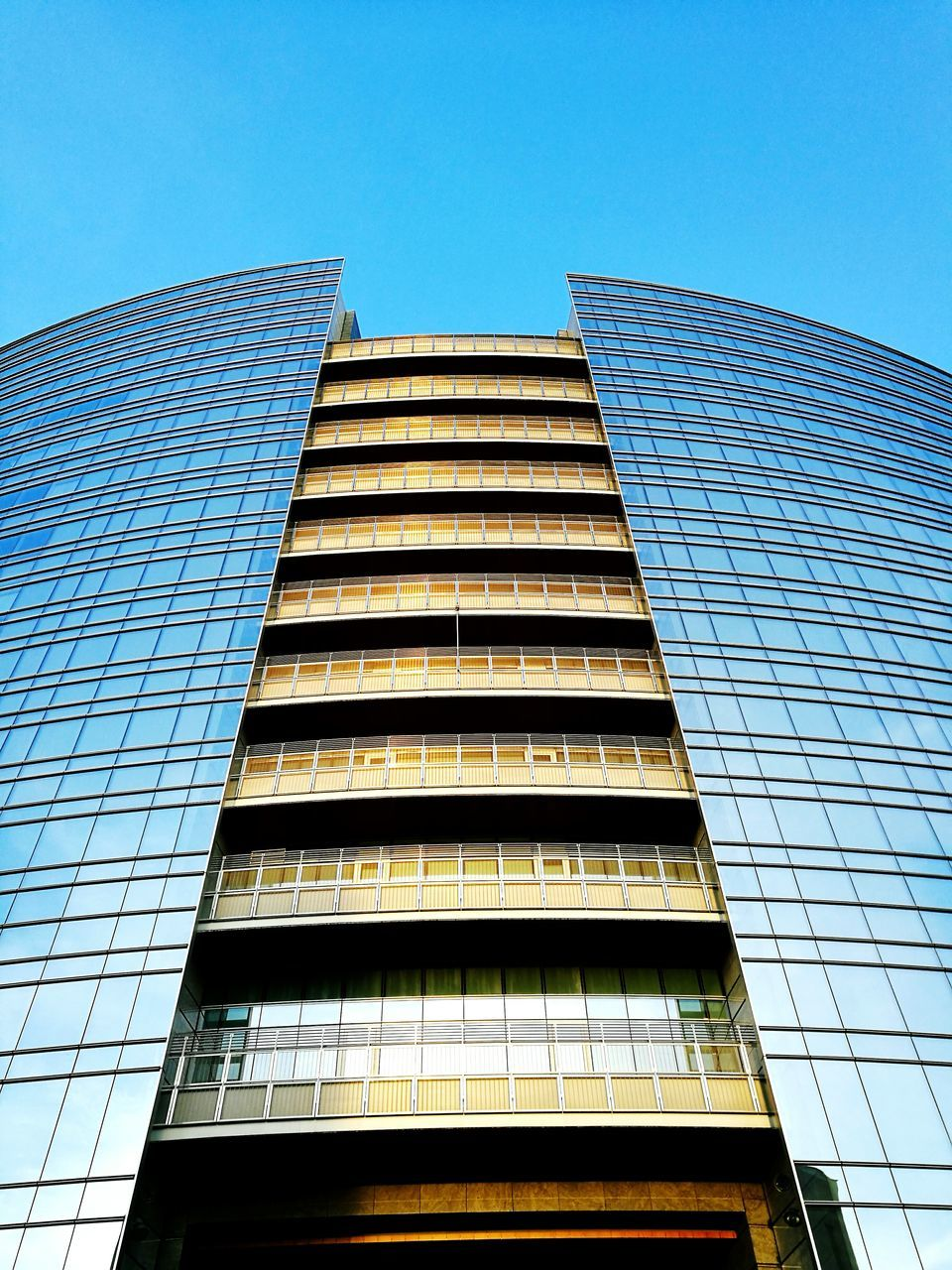 architecture, building exterior, low angle view, built structure, window, clear sky, skyscraper, modern, no people, day, blue, outdoors, sky, city