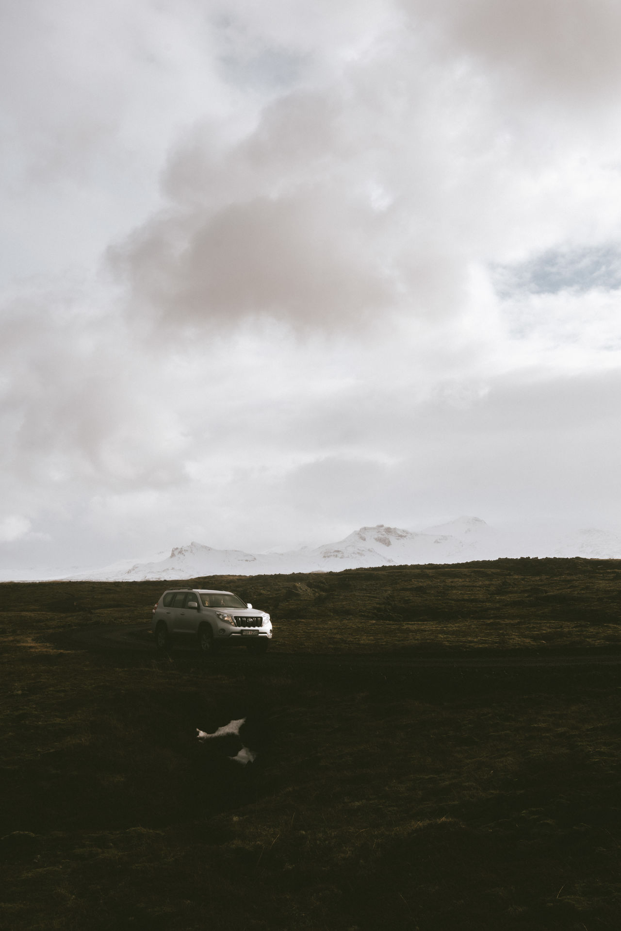 Car in the icelandic landscape 4x4 Beauty In Nature Car Cloud - Sky Day Field Grass Landscape Nature No People Outdoors Scenics Sky Tranquility Transportation
