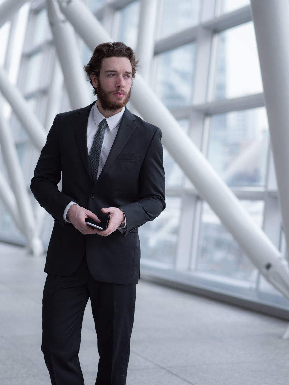Businessman Looking Away While Standing In Building