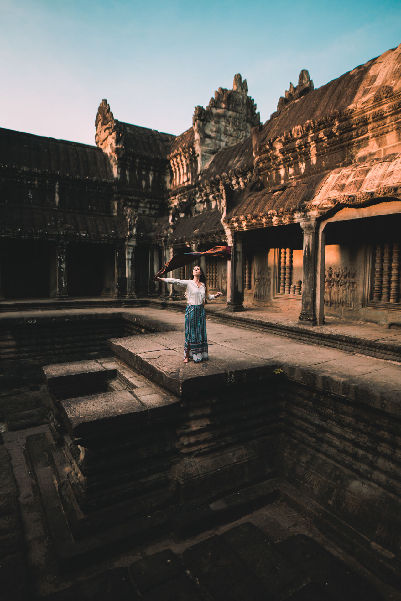 Something in the air Travel Adult One Person Travel Destinations Architecture Day Ancient Civilization Young Adult Standing Full Length One Woman Only Built Structure Culture Showcase May Angkor Wat Travel Travel Photography ASIA Cambodia Tourism Temple Wonder Of The World