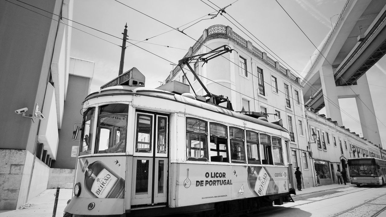 The old city Lisbon transportation, the Electric Car Architecture Building Built Structure Cable City City Life City Street Day Electrico De Lisboa Eye4photography  EyeEm Gallery Fresh On Eyeem  Information Sign Lisboa Lisboa Portugal Mode Of Transport Outdoors Power Line  Sky The Architect- 2016 Eyeem Awards
