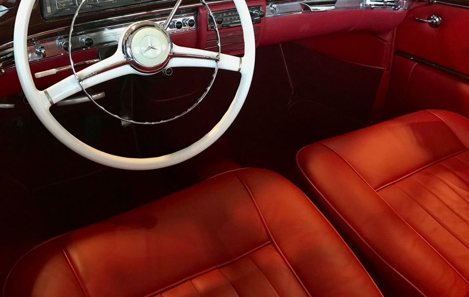 The white circle in red landscape Close-up Day Indoors  Luxury Mercedes-Benz No People Red Seat Vehicle Interior White Wheel
