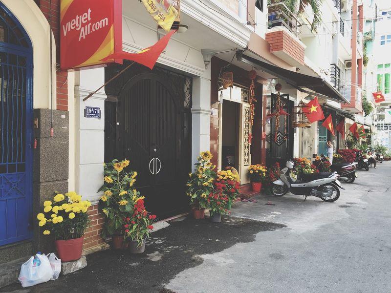 Asian street Socialism Vietnam Flags Hochiminh Tết Flowers Street Streetphotography Street