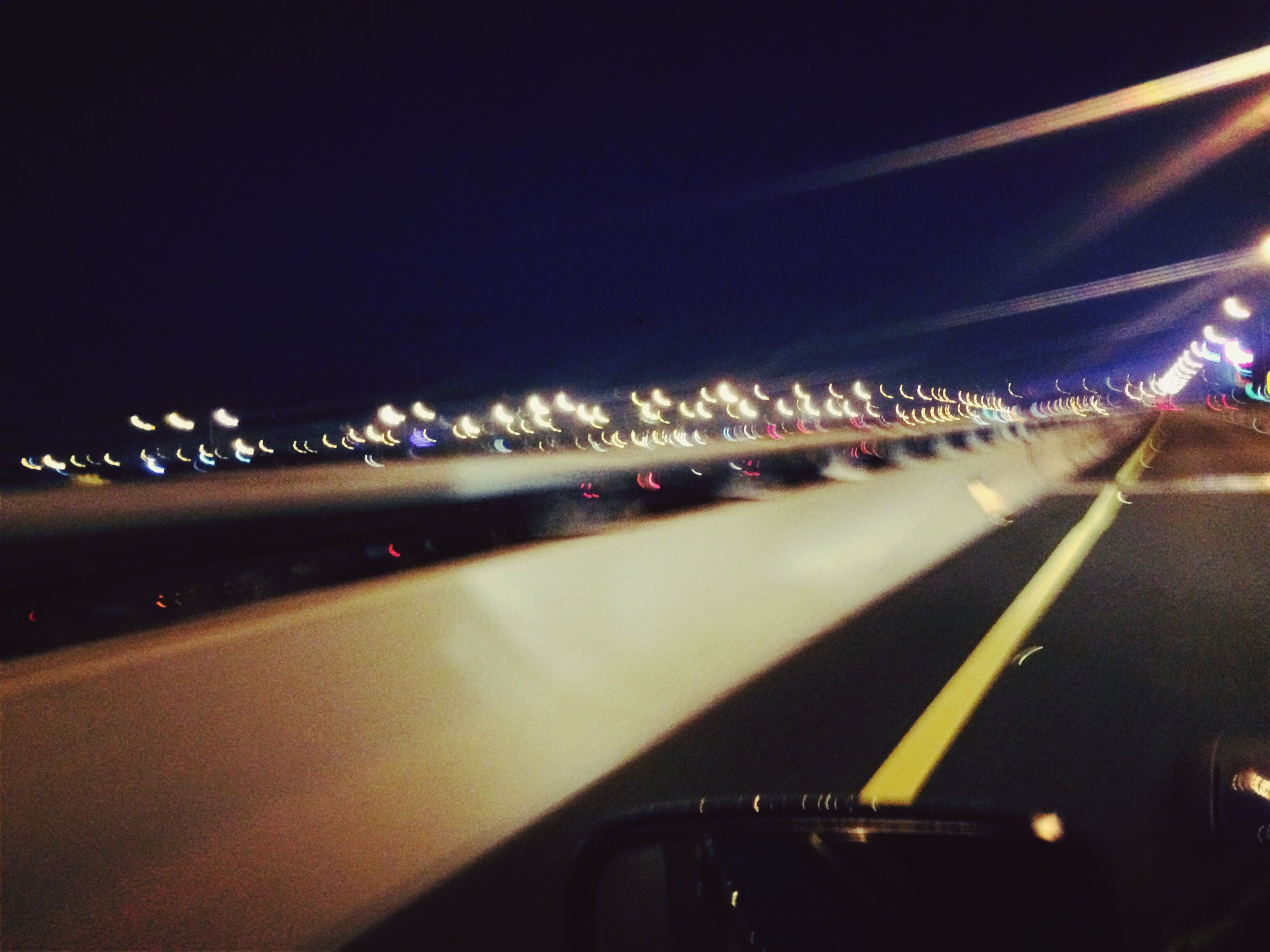 illuminated, transportation, night, road, mode of transport, road marking, car, the way forward, lighting equipment, land vehicle, diminishing perspective, street light, street, on the move, no people, highway, vanishing point, traffic, in a row, light - natural phenomenon