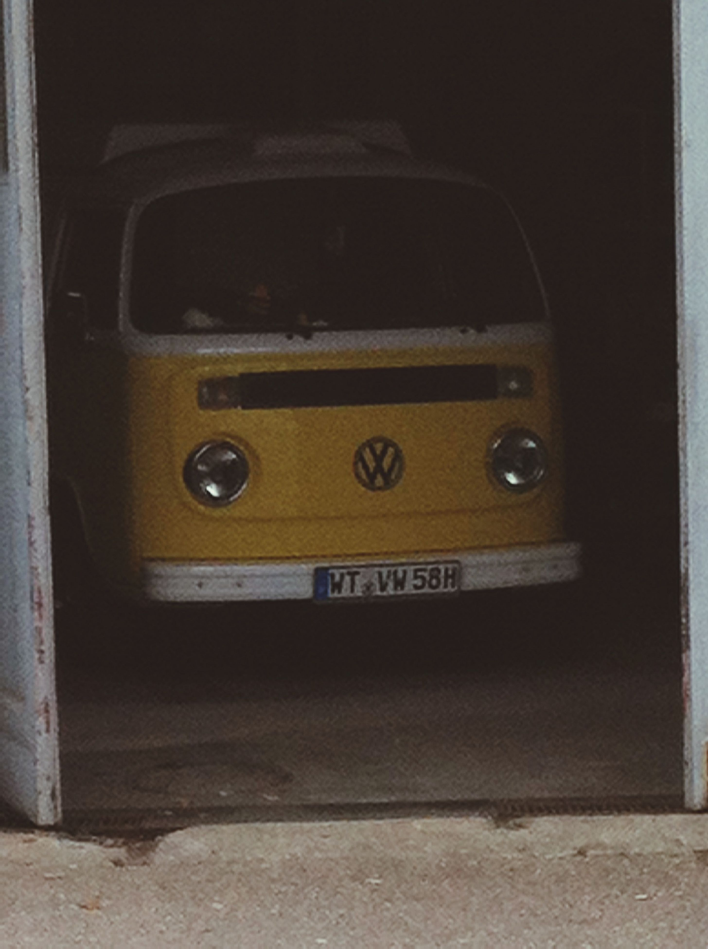 transportation, mode of transport, land vehicle, car, communication, text, yellow, western script, door, no people, number, close-up, old-fashioned, travel, road, indoors, public transportation, street, day