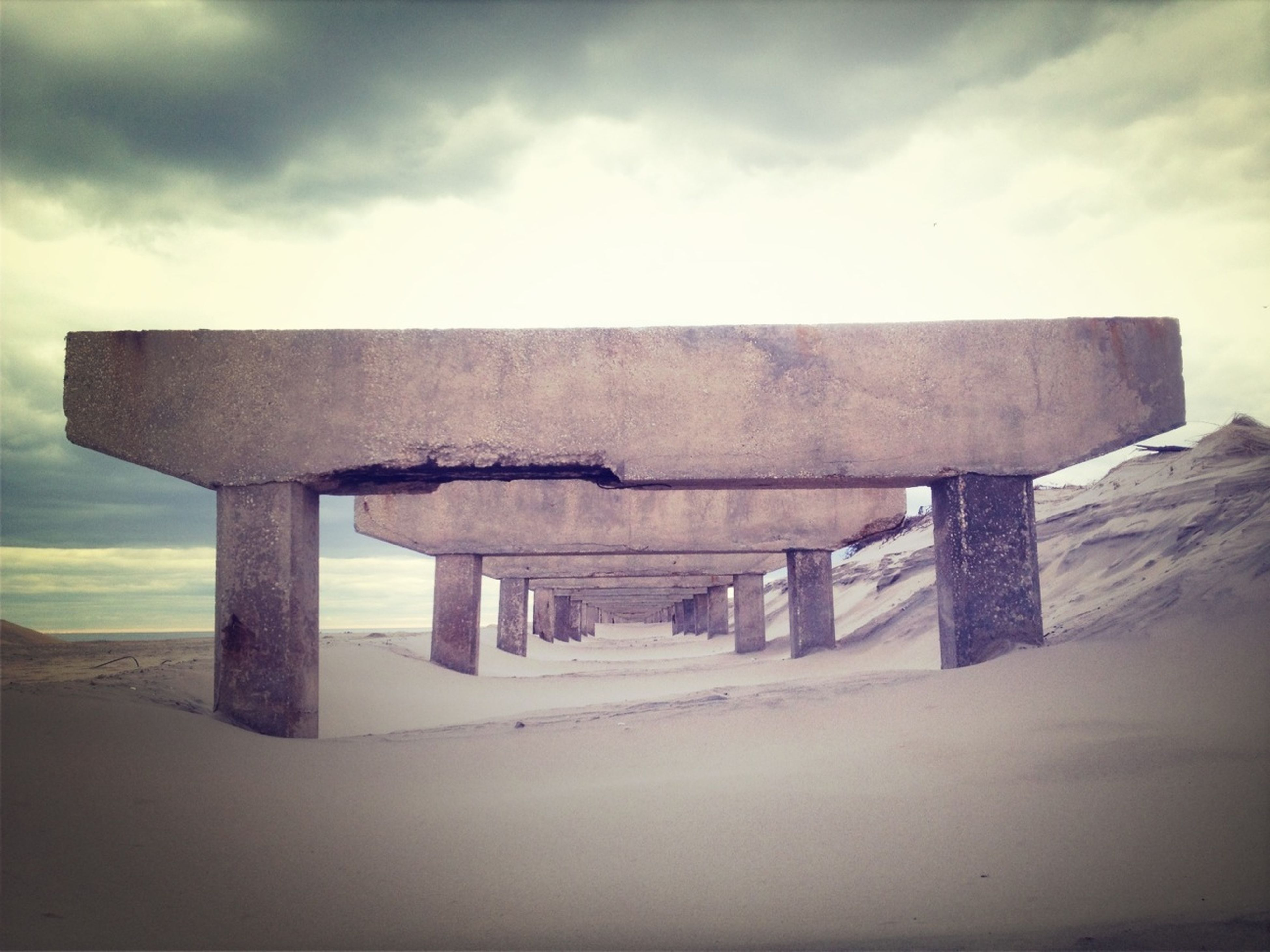 sky, cloud - sky, built structure, architecture, beach, sand, cloudy, sea, cloud, shore, tranquility, water, nature, tranquil scene, scenics, outdoors, horizon over water, day, no people, building exterior