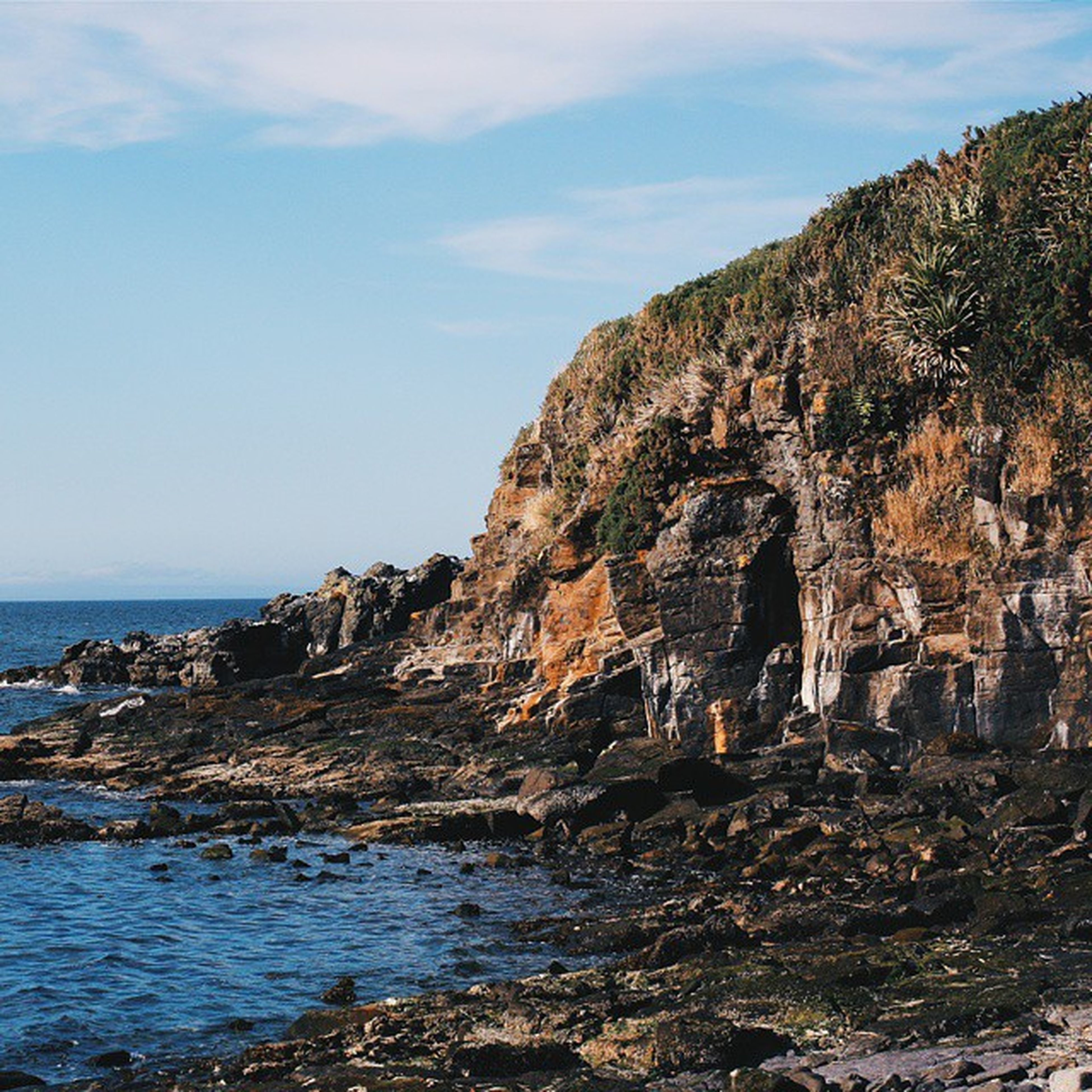 sea, rock formation, water, horizon over water, rock - object, scenics, tranquility, tranquil scene, sky, beauty in nature, cliff, beach, nature, shore, rock, idyllic, coastline, remote, day, geology