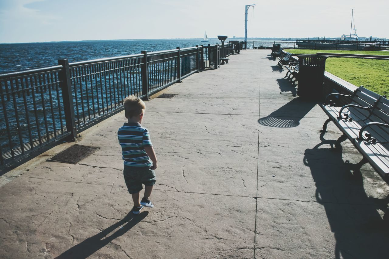 Leading The Way Boy Walking Independent  Childhood Long Walk Walking Pier Walkway Memory Lane Going Forward  Being Independent Being Adventurous Growing Up Ocean Walkway Lines The City Light