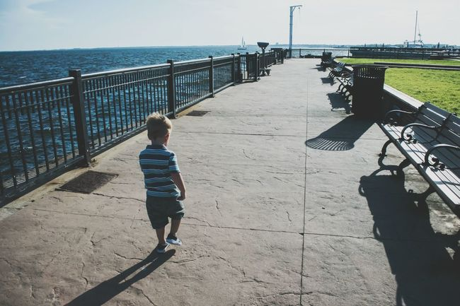 Leading The Way Boy Walking Independent  Childhood Long Walk Walking Pier Walkway Memory Lane Going Forward  Being Independent Being Adventurous Growing Up Ocean Walkway Lines