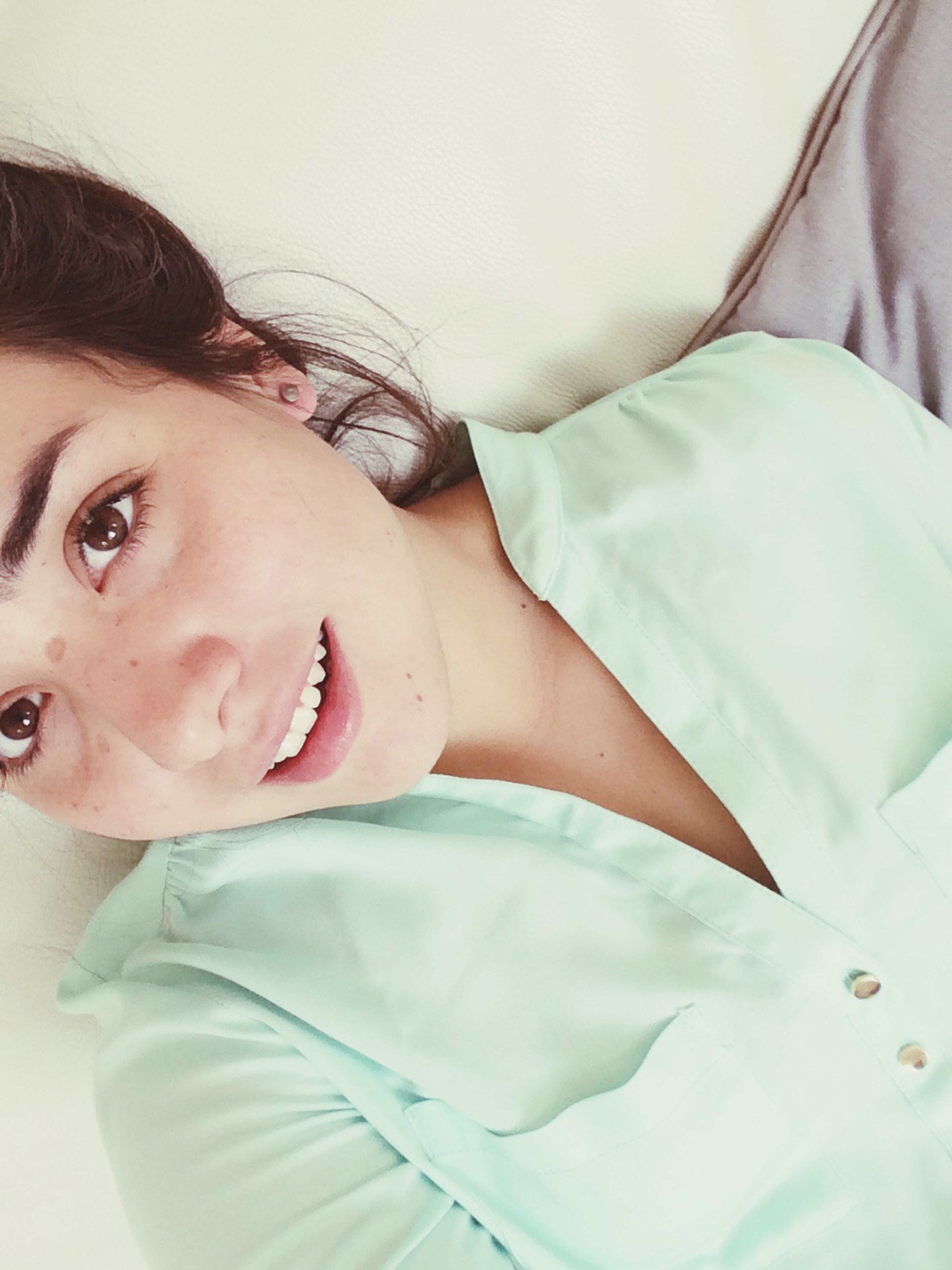 indoors, person, young adult, lifestyles, young women, bed, relaxation, leisure activity, home interior, headshot, front view, eyes closed, casual clothing, looking at camera, portrait, bedroom, lying down, close-up