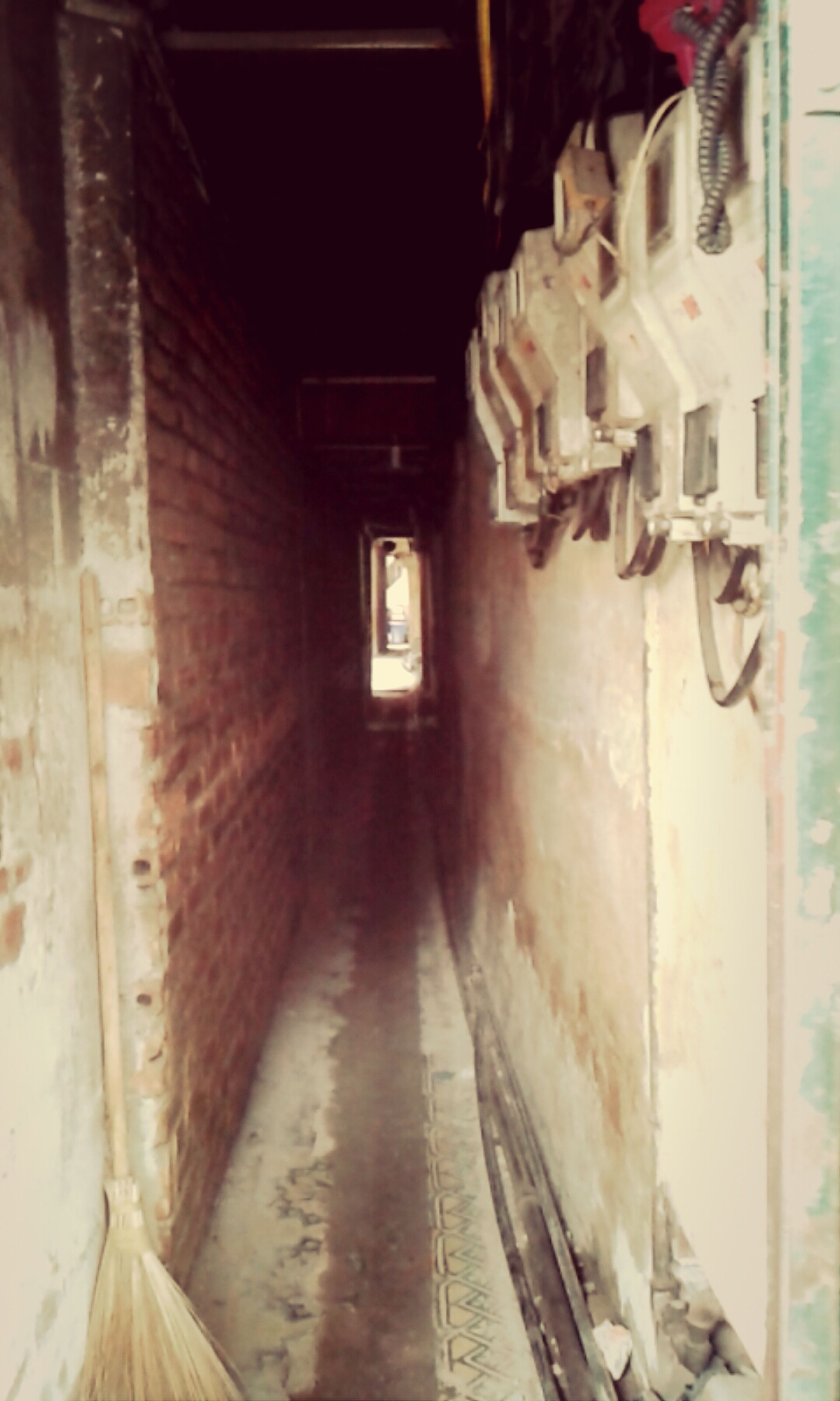 indoors, architecture, built structure, illuminated, old, wall - building feature, door, the way forward, wall, building, diminishing perspective, abandoned, corridor, no people, lighting equipment, entrance, night, interior, building exterior, narrow
