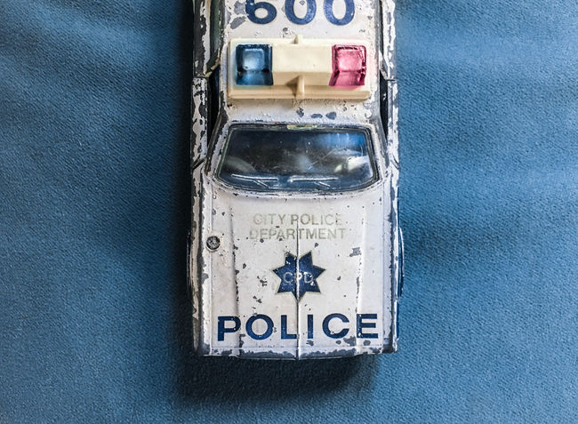 The old Car I Blue Damaged Dirty Emergency Light Full Frame Geometric Shape Glass - Material Metal No People Old Car Police Scratches Toy Car Toy Car Close Up