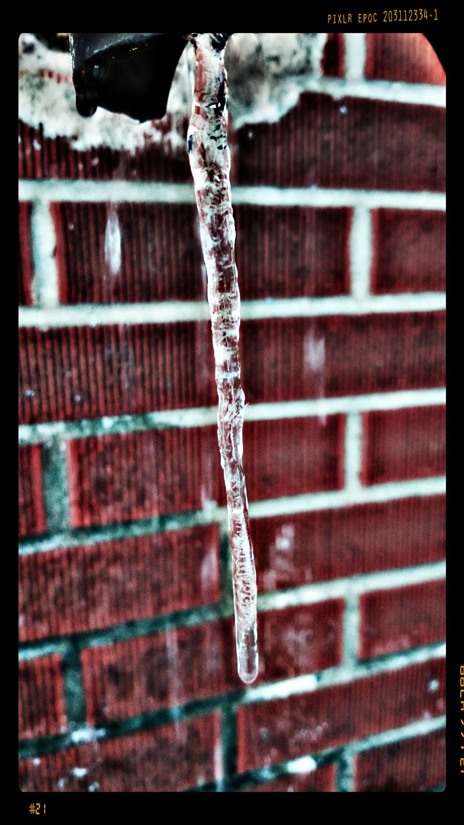 ...the icicle... Ice Icicles Icicle Brick Wall Frozen Photography Frozen Nature Freezing Cold ❄ Beautiful World Bold Red Sony Xperia EyeEm Gallery Eyeemphotography Transparency Transparent