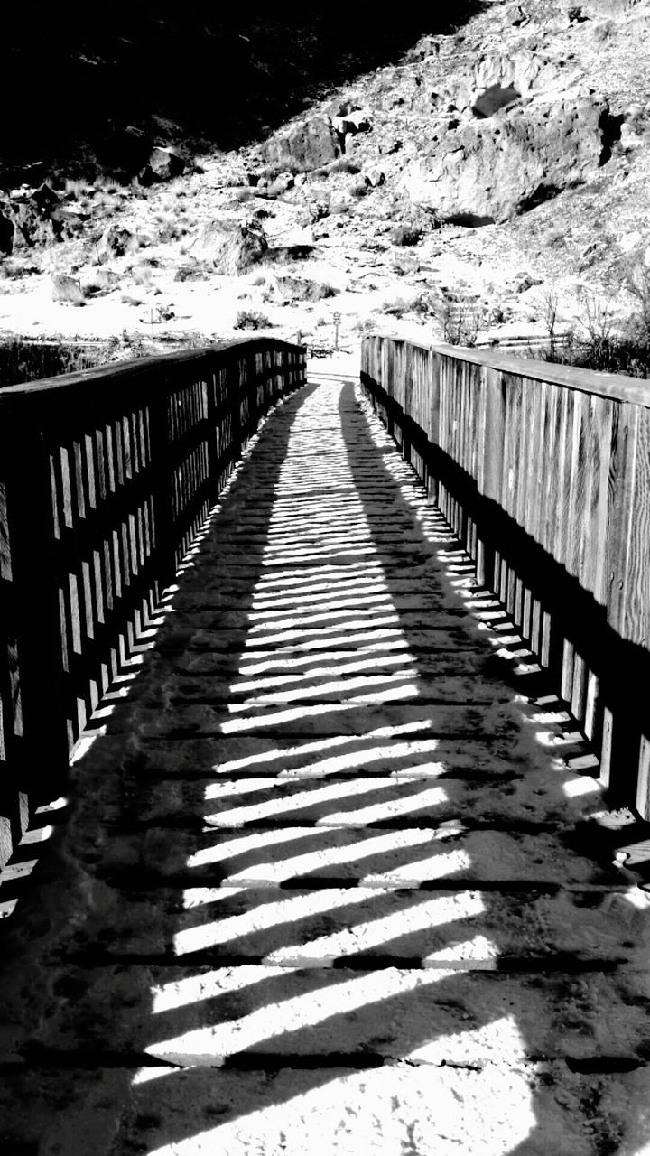 railing, sunlight, shadow, the way forward, outdoors, day, snow, nature, no people