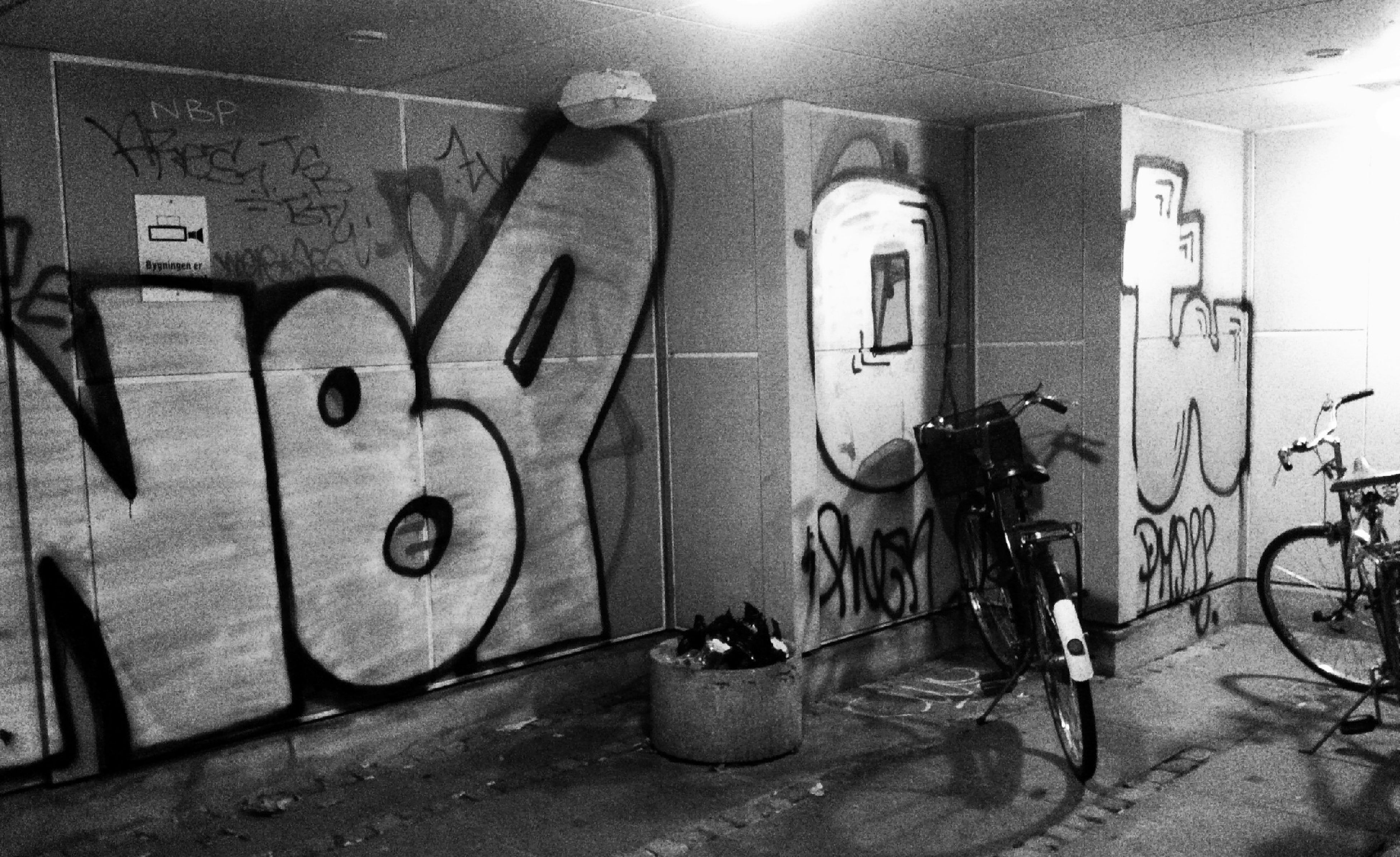 graffiti, wall - building feature, built structure, indoors, architecture, art and craft, wall, art, creativity, no people, bicycle, street art, day, door, abandoned, building exterior, metal, absence, old, text