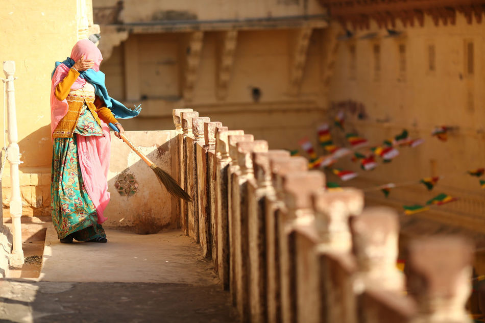 women sweeping the floor of Mehrangah fort. Adult Adults Only Day Fort Holding Mehrangarh One Person One Woman Only Only Women Outdoors People Religion Spirituality Traditional Clothing
