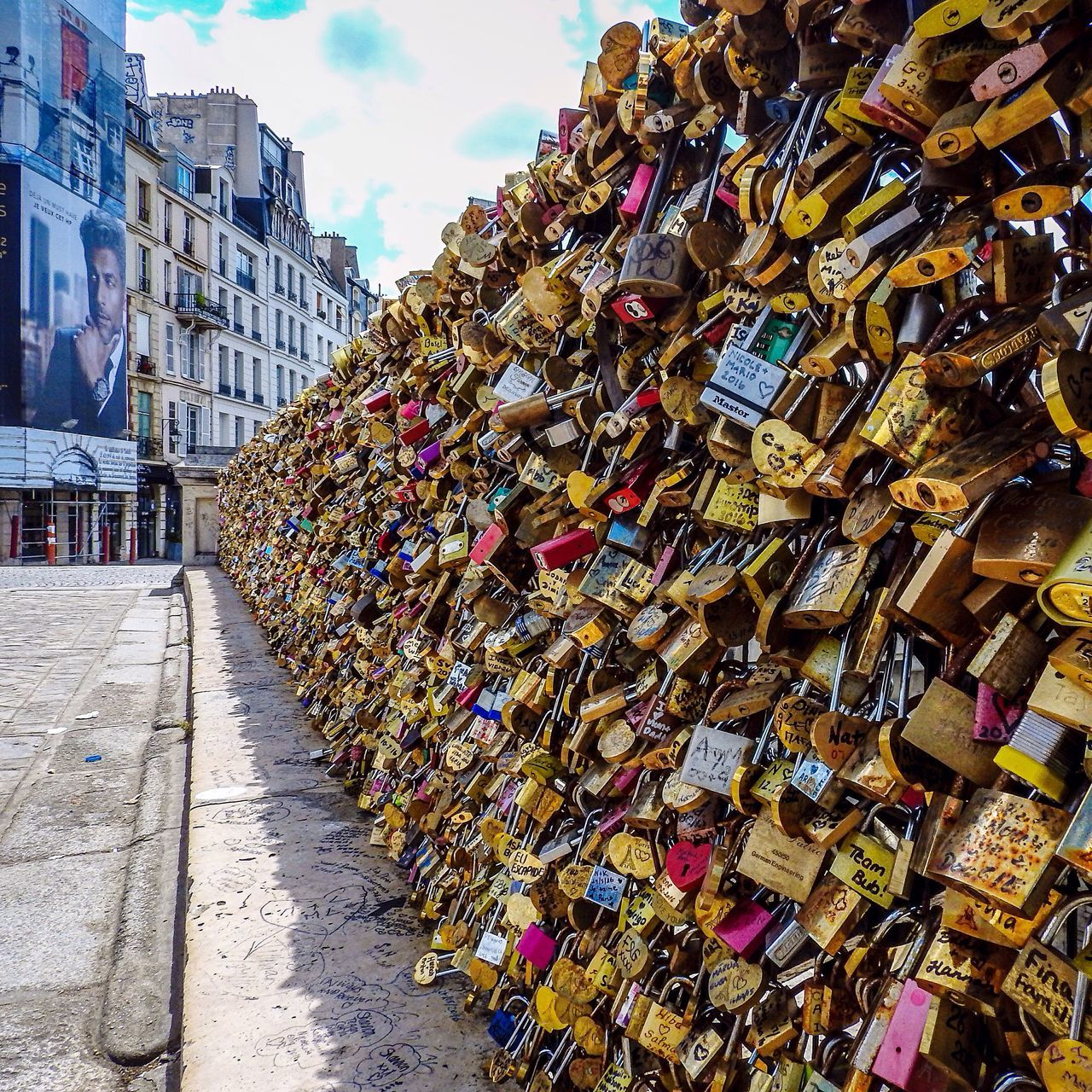 padlock, abundance, love lock, large group of objects, security, lock, love, railing, safety, protection, hope, architecture, metal, day, outdoors, variation, hanging, connection, hope - concept, bridge - man made structure, built structure, no people, building exterior, unity, sky, multi colored, oath, close-up