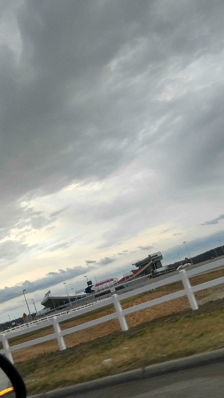cloud - sky, sky, transportation, no people, speed, outdoors, motion, day, airport runway, water, nature, architecture, sports race