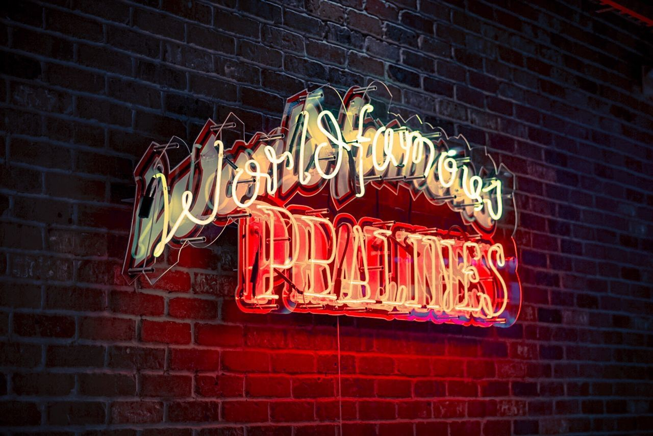 text, brick wall, illuminated, western script, neon, night, communication, retail, building exterior, no people, open sign, outdoors, store, low angle view, architecture, close-up