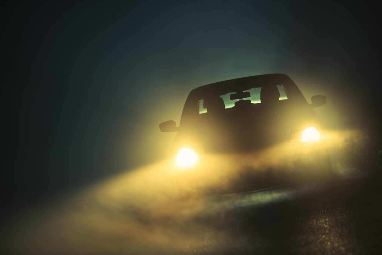 Driving a Car in Foggy Conditions. Extreme Fog on the Road. Beauty In Nature Car Fog Foggy Headlights Illuminated Land Vehicle Lens Flare Mode Of Transport Nature No People Outdoors Silhouette Sky Sun Sunbeam Sunlight Sunset Transportation Travel Traveling