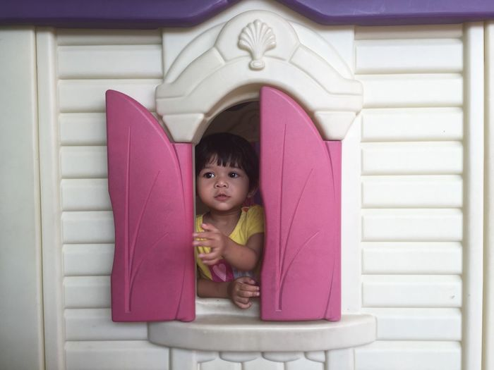 A Child Playing Millennial Pink Baby Childhood Close-up Cute Day Headshot Indoors  Innocence Lifestyles Looking At Camera One Person People Pink Color Pink Window Real People