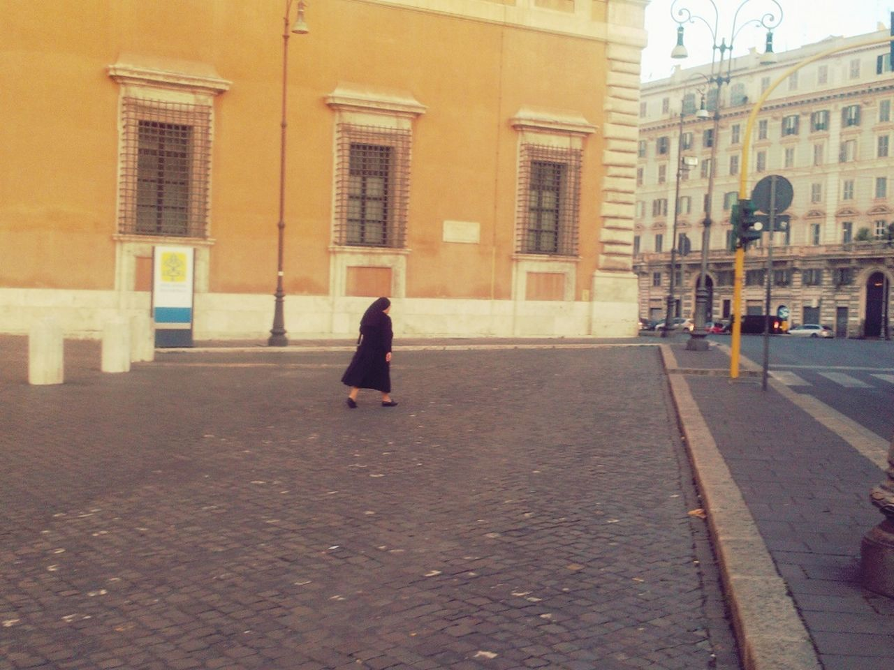 street, building exterior, walking, architecture, city, built structure, full length, road, outdoors, women, one person, pedestrian, day, people, adult
