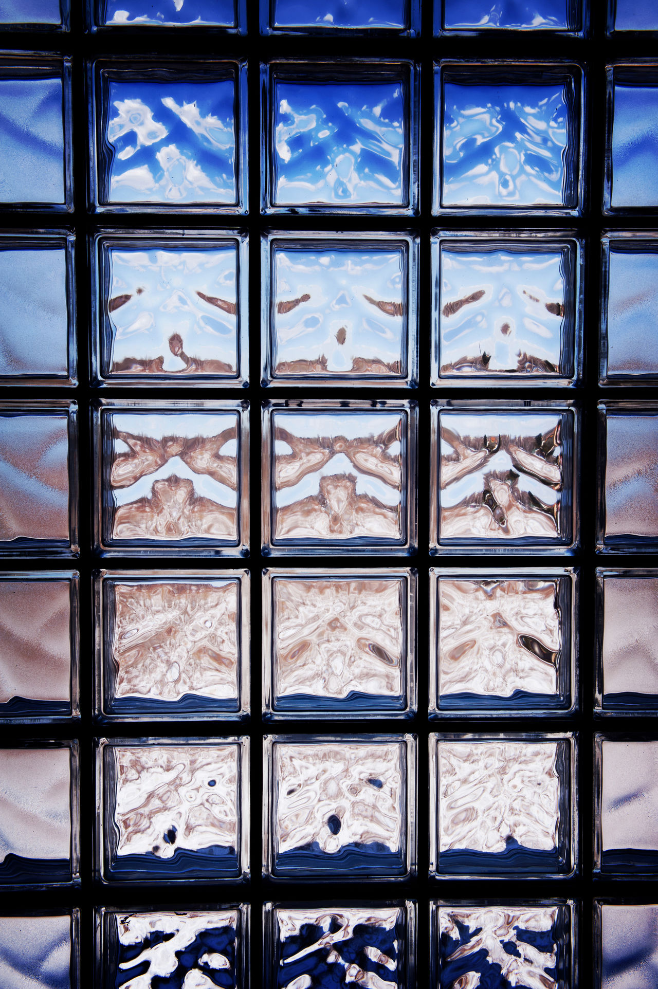 Blue toned glass brick window abstract with dark vignette, transparent glass blocks surface background in horizontal orientation, nobody. Abstract Abstracts Background Backgrounds Block Blocks Blue Brick Bricks Decor Empty Glass Glassbrick Luksfer No People Transparent Wall Window