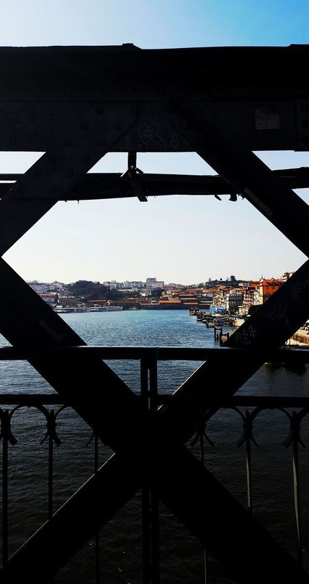 Relíquias sobre o Douro 💙 Treasures from Douro Treasures Window View Perspective River Bridge Water City Oporto Bridge - Man Made Structure Built Structure Architecture Metal Travel Destinations Outdoors Day No People Cityscape Sky Out Of The Box EyeEm PhonePhotography Samsung Galaxy S6 Edge Phonecamera Beauty In Nature