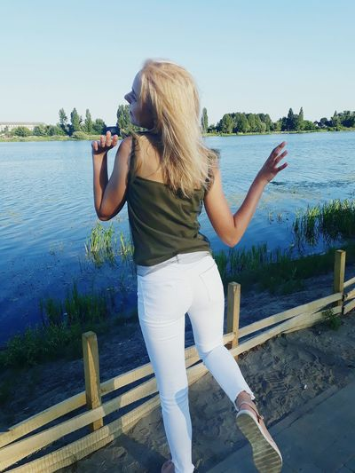 EyeEm Selects Rear View Nature Sky Young Women Young Adult Blond Hair One Person One Woman Only Only Women Water Adult Rear View People Adults Only Women Day Standing Outdoors One Young Woman Only Nature Human Body Part