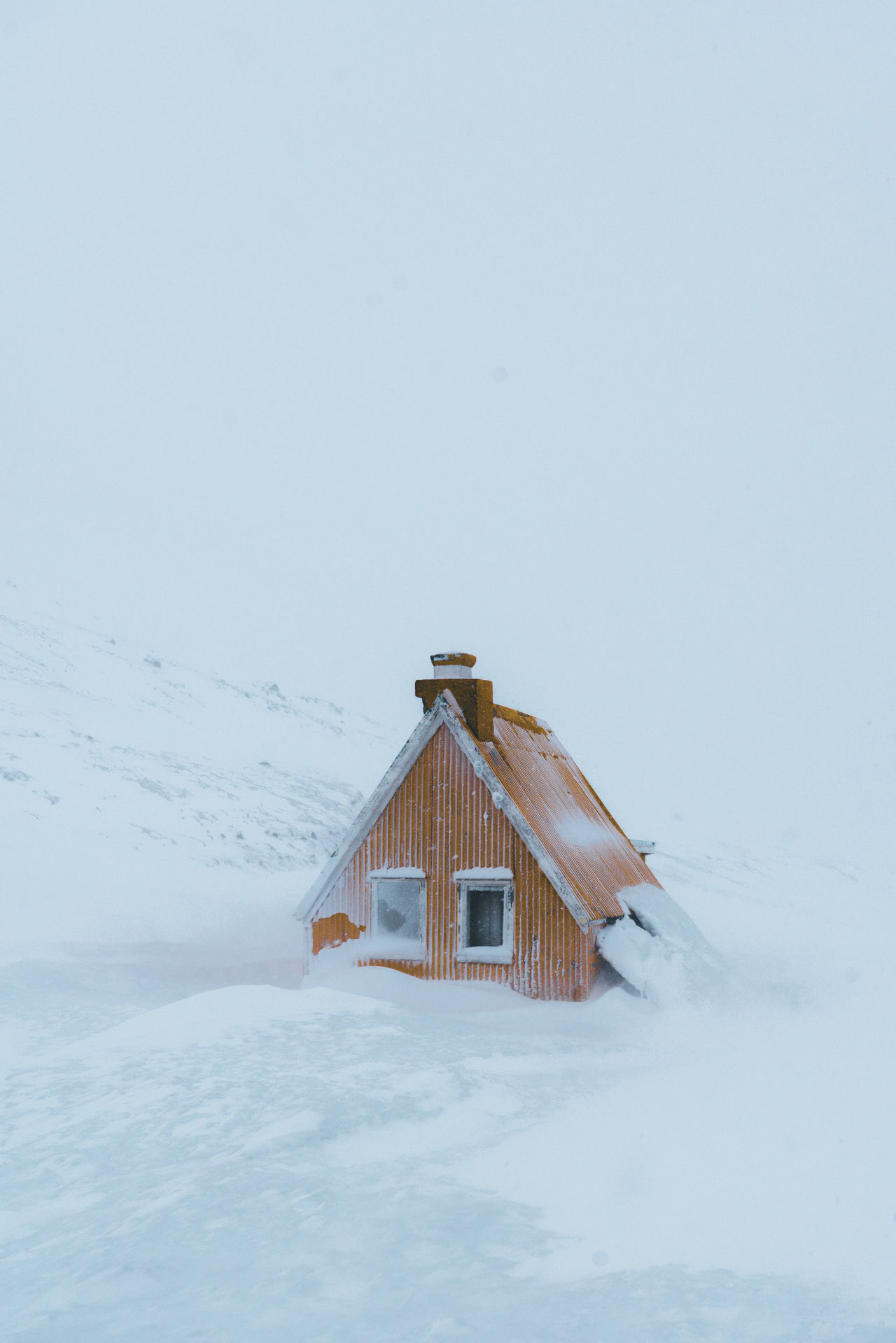 Cabin in a snowstorm in Iceland Architecture Beauty In Nature Building Exterior Built Structure Cold Temperature Day Field House Landscape Nature No People Outdoors Scenics Sky Snow Snowdrift Snowing Tranquility Weather Winter
