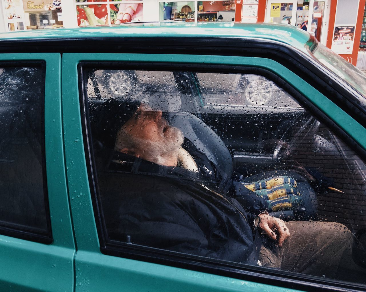 Nap time... Rainy Transportation Mode Of Transport Mature Adult Lifestyles Senior Men Steering Wheel Moments Of Life City Street My Favorite Photo Made In Romania Fresh On Eyeem  Leisure Activity Street Life VSCO Details Of My Life City Life Sleeping Sleep Time Nap Time Relax Time  Citylife Street Mobile City