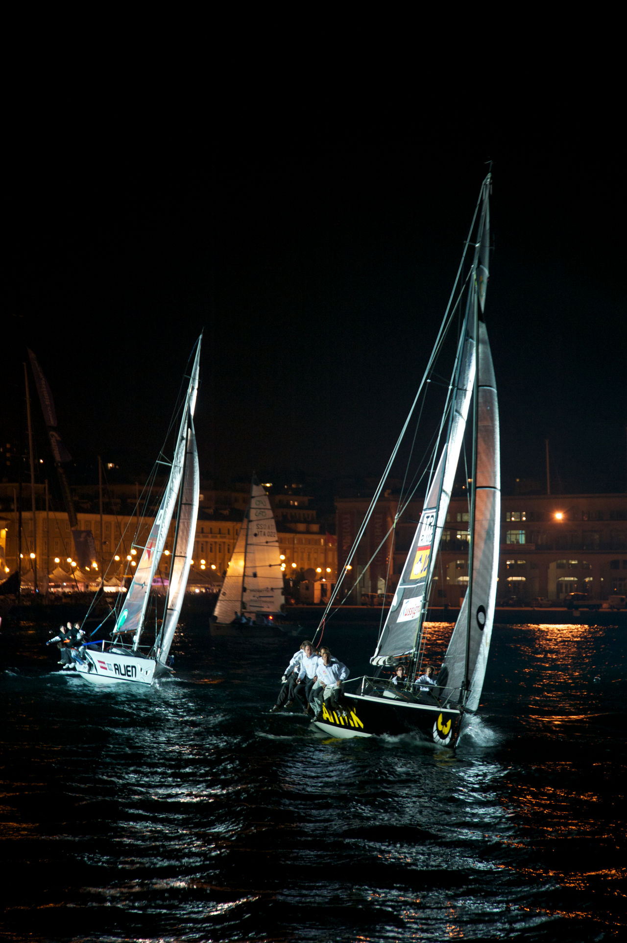 sail boats during the regata Barcolana at night Barcolana 2010 Competition Competitive Sport Nautical Vessel Night Outdoors Regatta Sailboat Sailing Sailing Ship Sailor Sea Sports Race Trieste TriesteSocial Water Travel Pictures Summertime Waterfrontview Welcome To Black