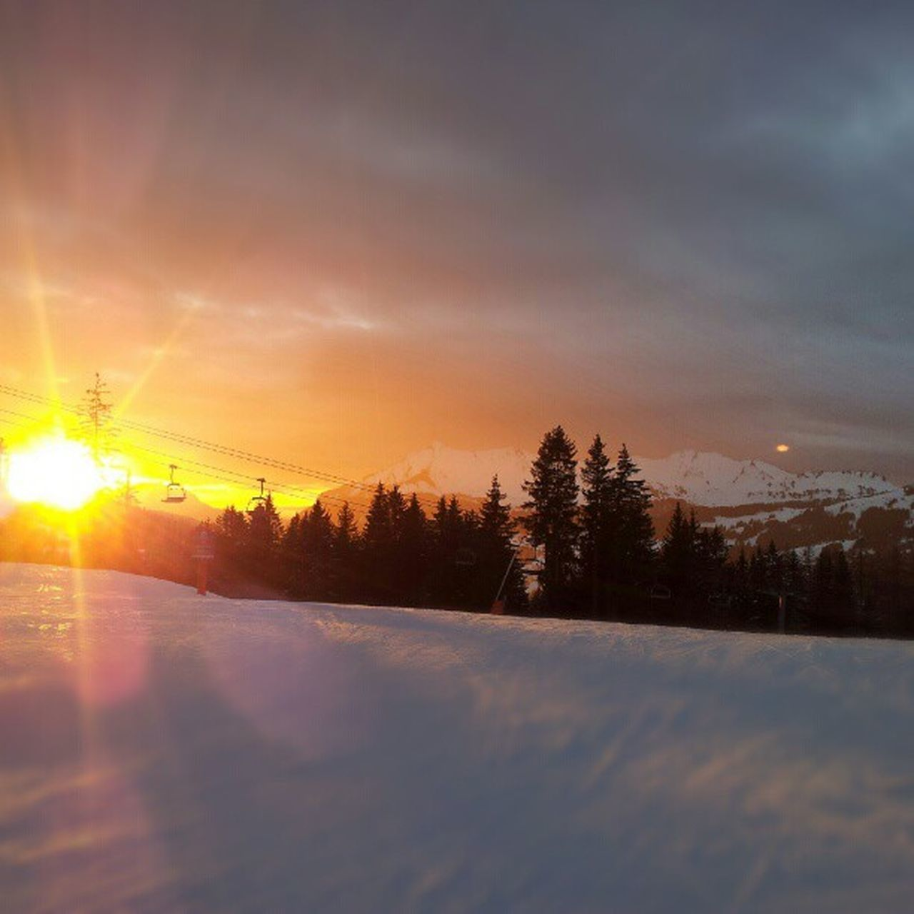 sunset, winter, nature, snow, cold temperature, scenics, sun, beauty in nature, tranquil scene, sky, tranquility, weather, tree, no people, outdoors, landscape, sunlight, day