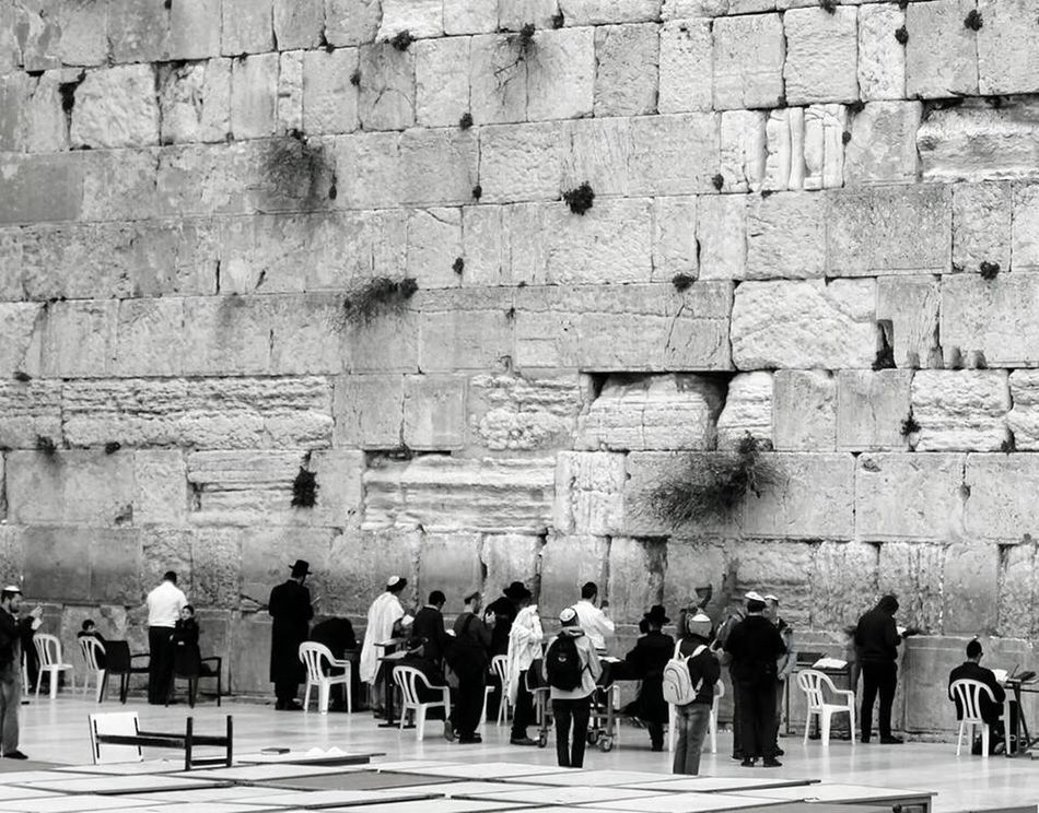 Large Group Of People Place Of Worship Wishes Holy Wall Jerusalem Praying Lifestyles Built Structure Building Exterior Holy City History Men Notes To Leave Behind Emotions