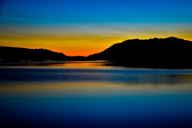 Colors of winter Mountain Tranquil Scene Scenics Beauty In Nature Scenics Mountain Tranquil Scene Water Sunset Blue Tranquility Silhouette Beauty In Nature Idyllic Waterfront Mountain Range Nature Calm Reflection Sea Majestic Non-urban Scene Sky Remote