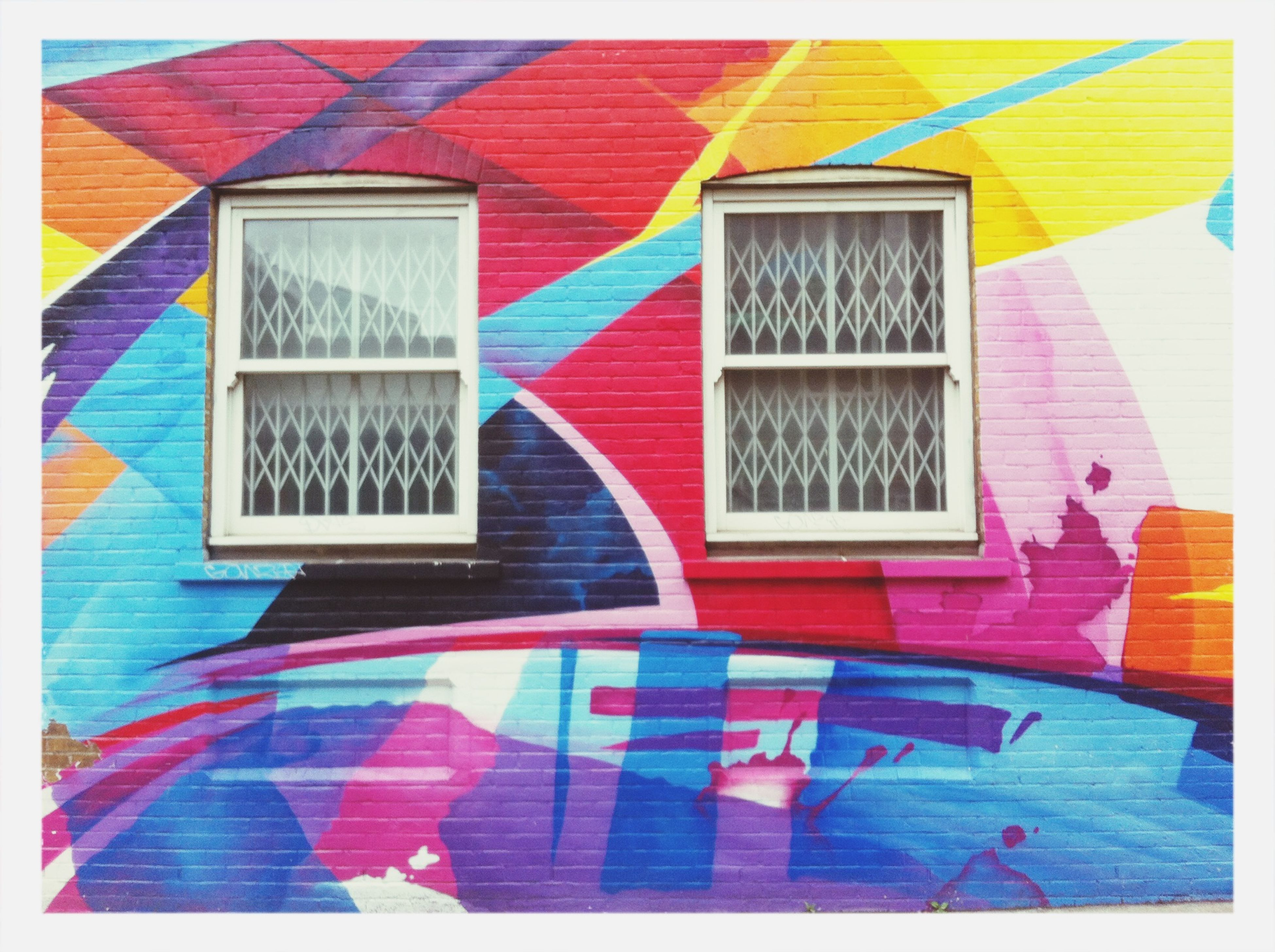 transfer print, auto post production filter, architecture, built structure, building exterior, multi colored, blue, red, wall - building feature, sunlight, day, window, yellow, wall, no people, house, shadow, outdoors, shutter, pattern