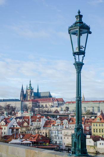 View of St Vitus cathedral with Lampost in foreground Castle Charles Bridge Prague Architecture Building Exterior Built Structure Citiscape  Cityscape Lamppost Outdoors St Vitus Cathedral