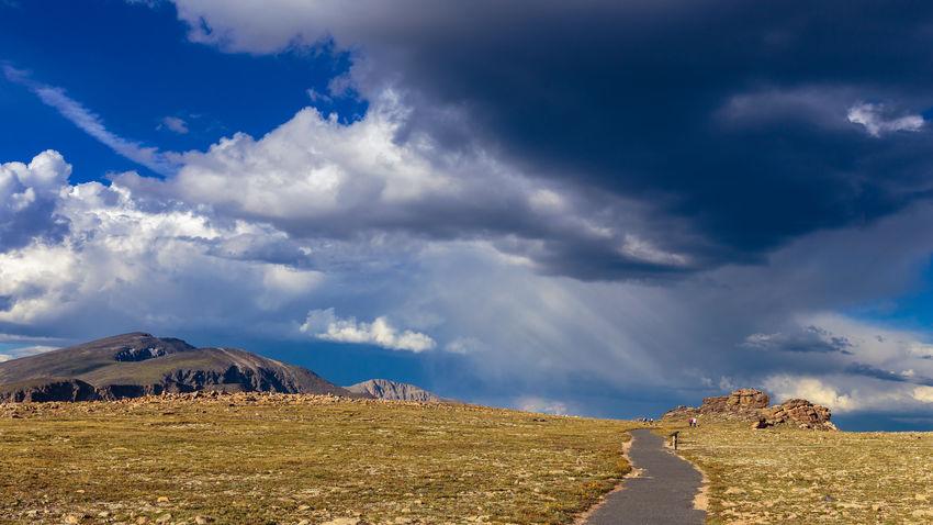 August Cloud - Sky Cloudy Colorado Hiking Trail Horizon Over Land Landscape Mountain Non Urban Scene Non-urban Scene Rock Formation Rocky Mountain National Park Scenics Sky Storm Cloud Trailhead Travel Destinations Tundra Communities Trail Unrecognizable Person Copy Space