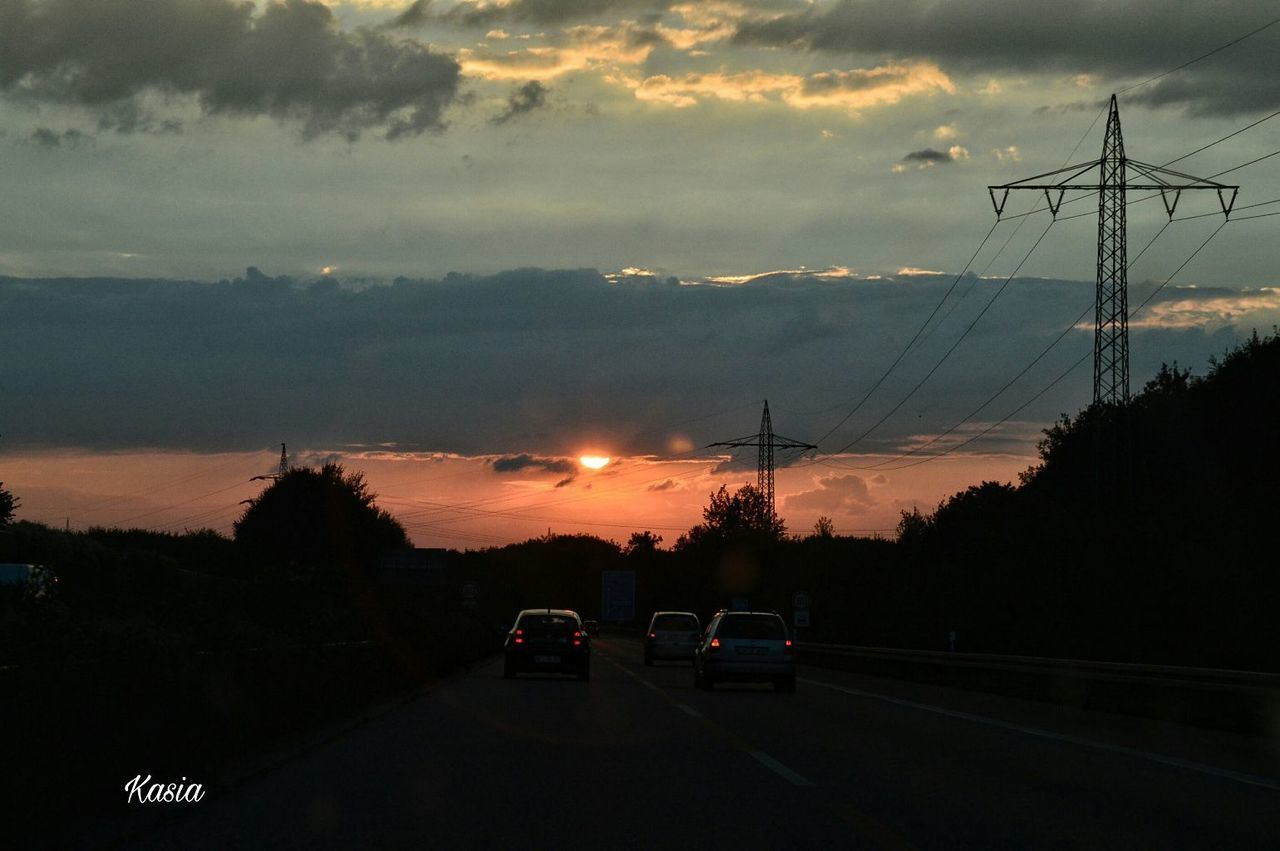 car, sunset, sky, land vehicle, cloud - sky, transportation, mode of transport, no people, cable, outdoors, electricity, road, electricity pylon, nature, tree, scenics, beauty in nature, day