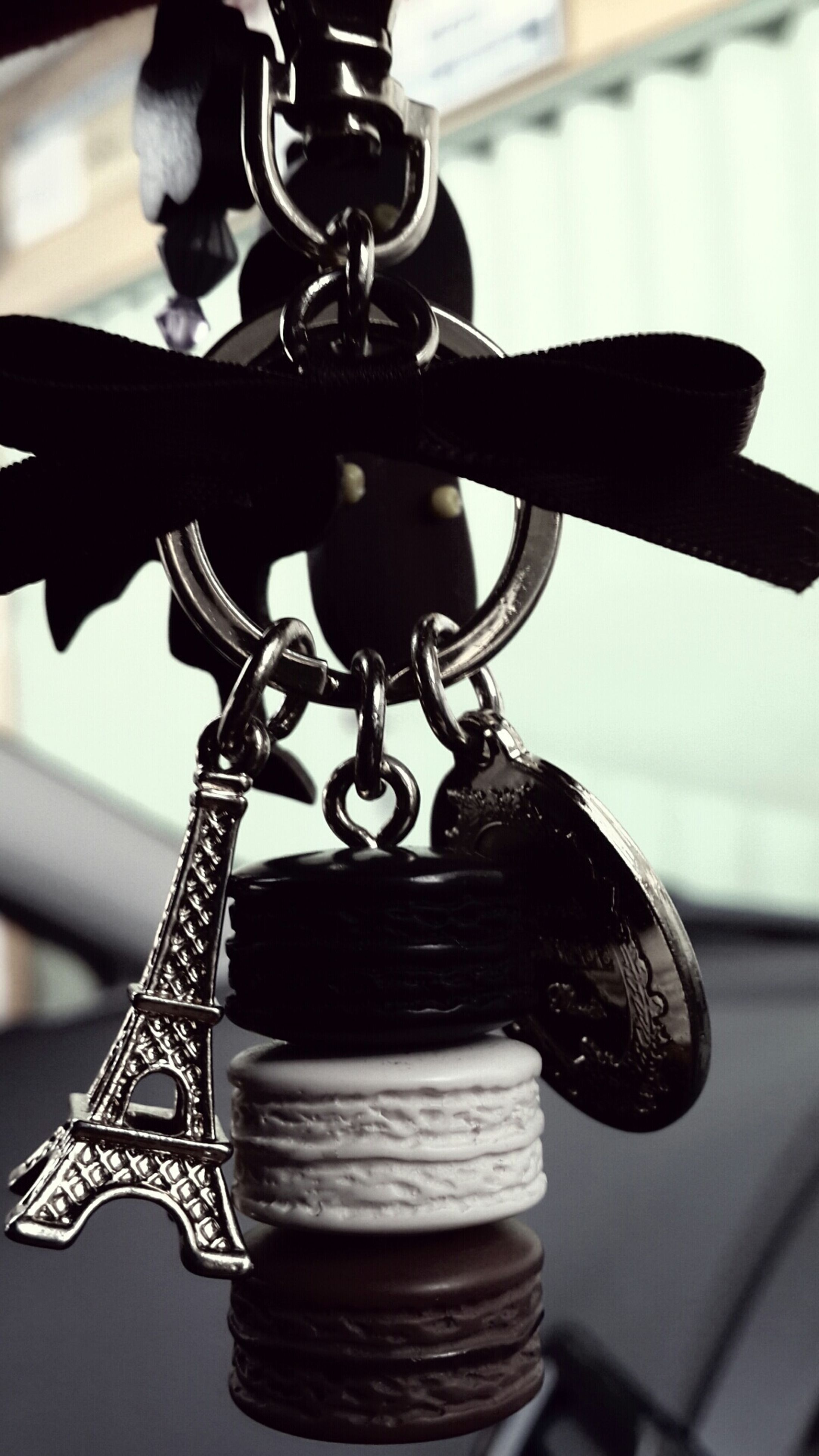 metal, focus on foreground, close-up, metallic, indoors, still life, hanging, part of, selective focus, chain, no people, cropped, reflection, shiny, day, table, single object, water, old-fashioned, detail