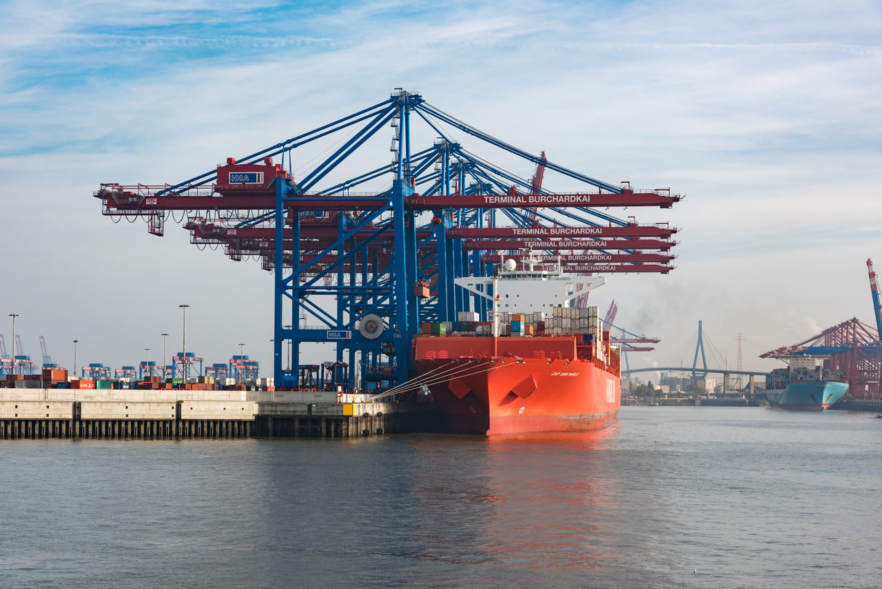 Hamburg, Germany - November 01, 2015: Red ontainer ship Cap San Marco gets unloaded at the harbor terminal Burchardkai. Blue Sky Cargo Container Colorful Commercial Dock Container Container Ship Container Ship Crane Documentary Freight Transportation Germany Hamburg Harbor Harbor High Resolution Maritime P Promenade Scenics Ship Shipping  St. Pauli Transportation Vessel Water