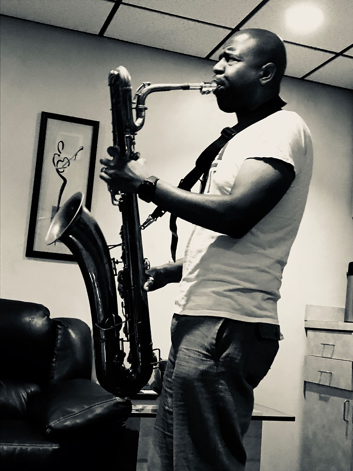 Howard Wiley warming up in the breakroom at Sunset Sound with his Bari(tone) saxophone; such a cool instrument. Casual Clothing One Person Lifestyles Musician Recording Recording Studio Hollywood Musical Instrument Saxophone Bari Sax Music Studio IPhoneography