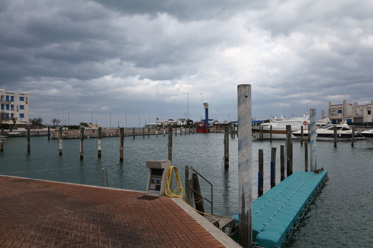 Cattolica Architecture Building Exterior Built Structure City Cityscape Cloud - Sky Clouds Cloudy Day Harbor Moored Nature Nautical Vessel No People Outdoors Pole In Water Poles In To The Water Poles In Water Sea Sky Water