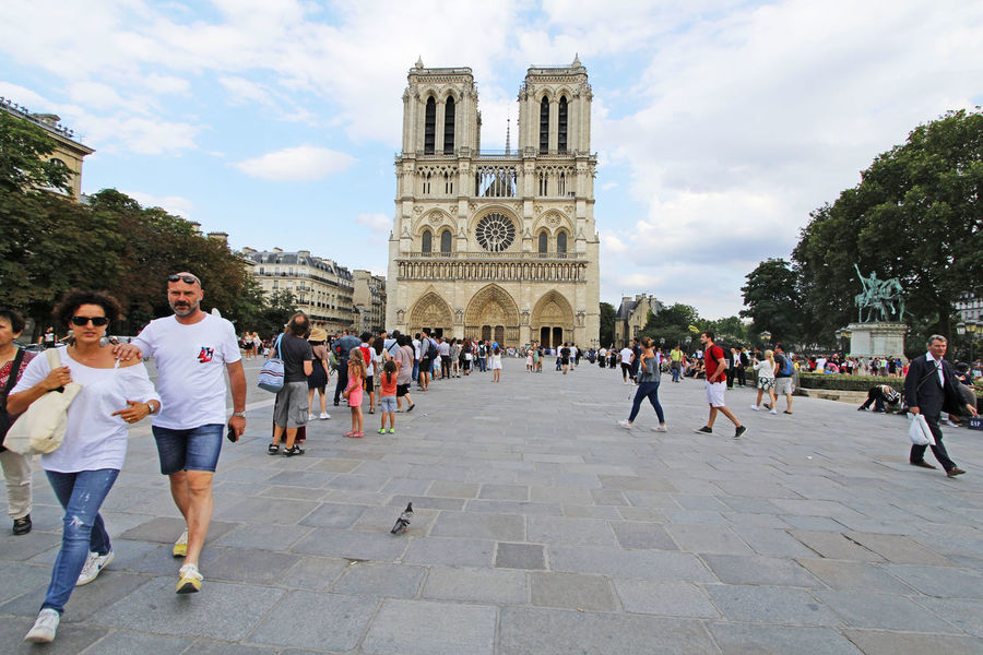 Notre Dame is one of the largest and most well-known churches in the world Architecture Blue Sky Cathedral France Gargoyle Gothic Gothic Architecture Historical Building Landmark Notre Dame Cathedral Notre-Dame Paris Tourist Attraction  Tourists White Clouds
