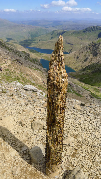 Penny post on Snowdon. Coins pushed into a wooden post, left by hikers on the ascent of Snowdon. Day Landscape Mountain Mountain Peak Mountain Range Nature Outdoors Penny Board Physical Geography Snowdon Wooden Post The Great Outdoors - 2016 EyeEm Awards Finding New Frontiers